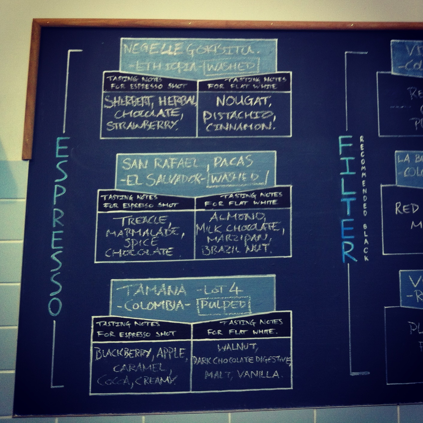 blackboard with large selection of different coffee beans